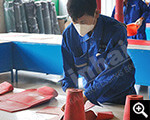 Worker is cutting wear-resistant rubber plate
