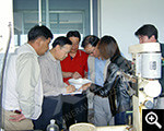 Xinhai president Zhang Yunlong with clients viewed products from experiments